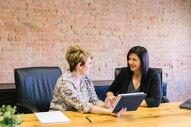 women discussing employee benefits